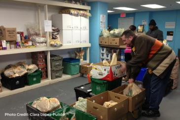 Alewife Food Pantry Volunteers giving back. A volunteer prepares food on the National Day of Service